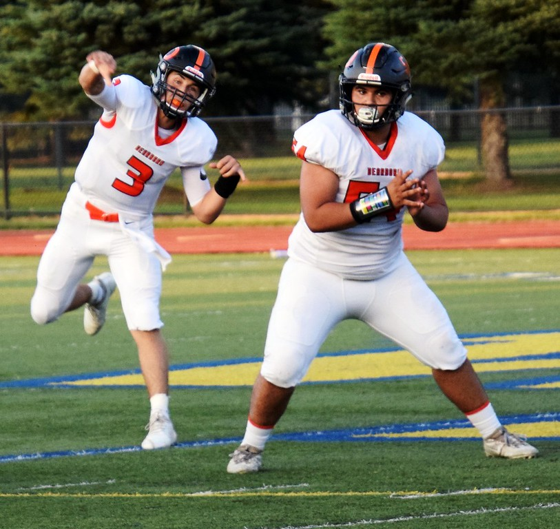 . Dearborn High quarterback Nick Tafelski (3) is protected by lineman Joey Fakhoury after throwing the ball during a road game at Wayne Memorial on Friday night. The Pioneers ultimately came away with a dominating 52-6 road victory. Alex Muller - For Digital First Media