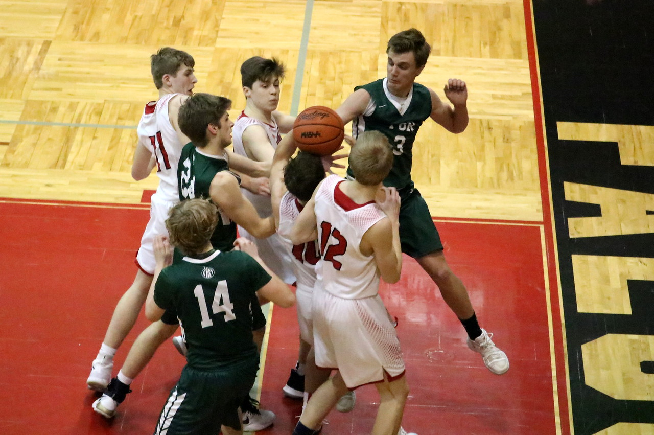 Host Divine Child defeated Ann Arbor Gabriel Richard 68-54 in the Class B, District 44 championship game on Friday night. Photo by Ryan Dickey - For The Press & Guide