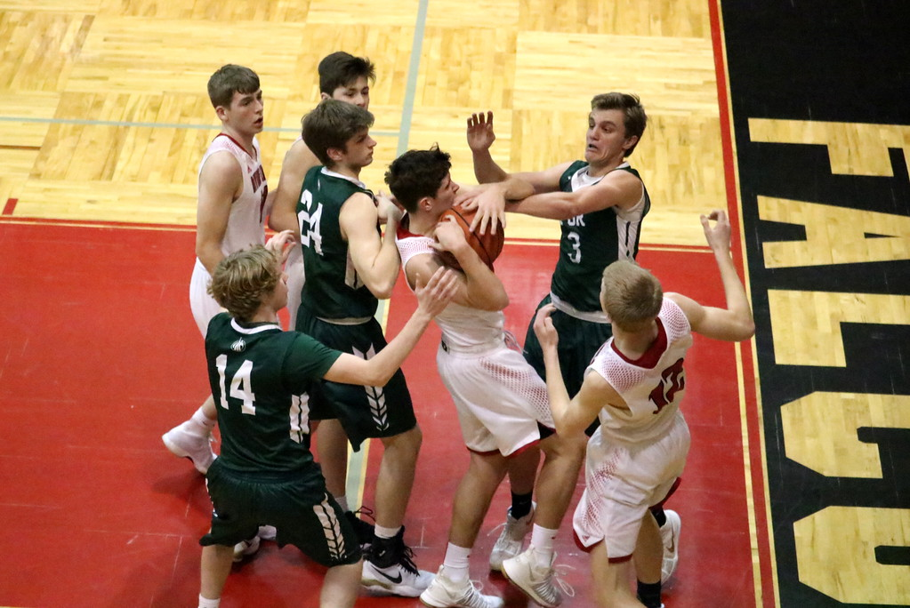 . Host Divine Child defeated Ann Arbor Gabriel Richard 68-54 in the Class B, District 44 championship game on Friday night. Photo by Ryan Dickey - For The Press & Guide