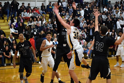 Crestwood welcomed in Edsel Ford on Friday night and held on for a 56-55 victory over the Thunderbirds. Photo by Alex Muller - For the Press & Guide