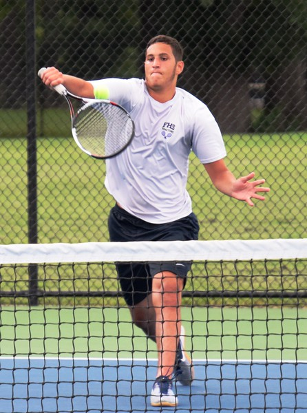 Fordson's No. 3 singles player Mohamed Kayed helped guide the Tractors to a 5-3 victory on Wednesday afternoon at Edsel Ford. Alex Muller - For Digital First Media