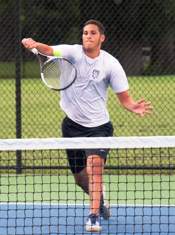 . Fordson\'s No. 3 singles player Mohamed Kayed helped guide the Tractors to a 5-3 victory on Wednesday afternoon at Edsel Ford. Alex Muller - For Digital First Media
