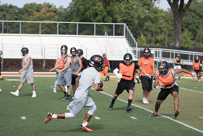 Dearborn High took the field on Monday for  the first official day of practice in Michigan. The Pioneers are coming off a 9-2 season, which included a trip the district championship game. (Photo Gallery by Jack VanAssche)