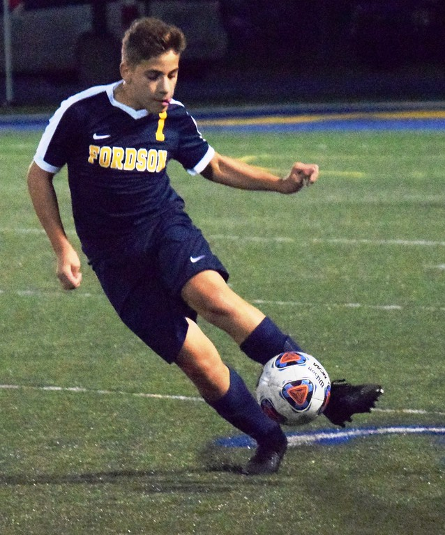 . Hussein Issa of Fordson kicks the ball during his team\'s battle with visiting Westland John Glenn on Wednesday night. The Tractors ultimately went on to a 3-1 victory and remained undefeated and in sole possession of first place in the KLAA East. Alex Muller - For Digital First Media