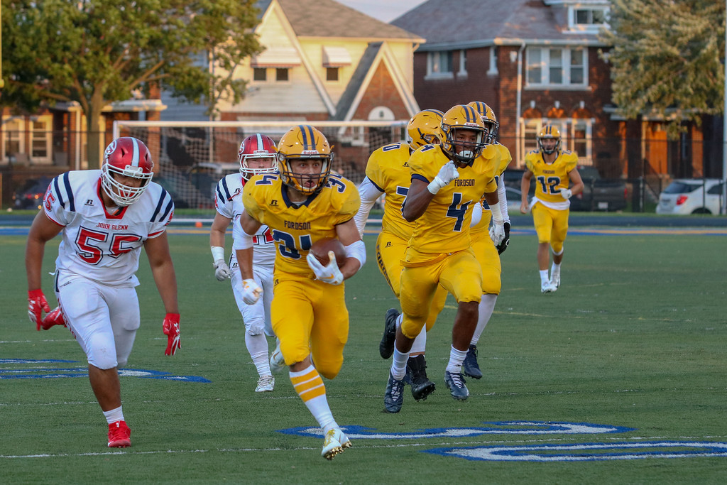 . Fordson running back Abe Jaafar (34) takes off toward the end zone on Friday night during the Tractors KLAA East battle with Westland John Glenn. Jaafar and the host Tractors ultimately rolled to a 49-28 victory over the Rockets.  Jack VanAssche - Digital First Media