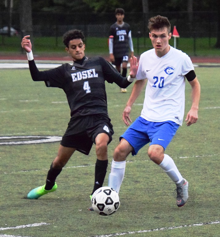 . Abdullah Nassr of host Edsel Ford tries to stop Gibraltar Carlson\'s Blake Smerigan during Monday\'s Downriver League matchup. Smerigan and the Marauders ultimately came away with a 5-1 victory. Alex Muller - For Digital First Media