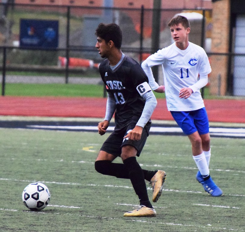 . Edsel Ford\'s Mohamed Alhuzaee (13) looks to head down the field on Monday against Aidan Ostrowski and the visting Gibraltar Carlson Marauders. The Thunderbirds went on to suffer a 5-1 defeat. Alex Muller - For Digital First Media