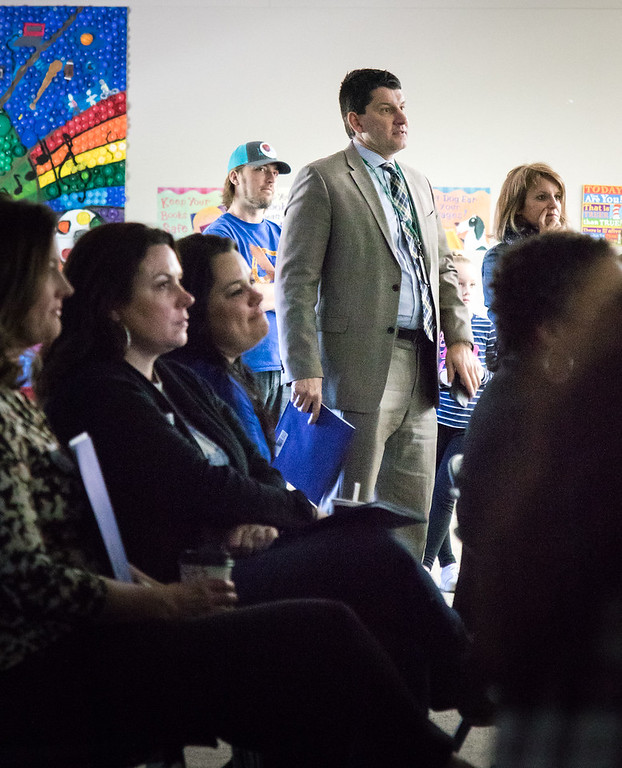 . Dr. Glenn Maleyko, Superintendent of Dearborn Public Schools, watches as students introduce a video produced by the student Broadcast Club. Photo by Debbie Malyn.