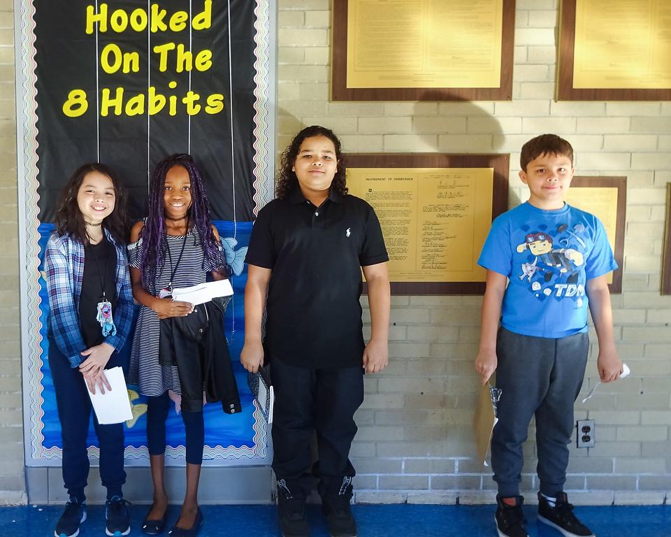 . Whitmore students Lolarose Song, Yaisa Jones, King Rolack and Seth Ramirez. Photo by student Broadcast Club member Lily Majcher.