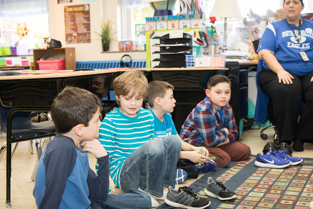 . During Habit Time, students tried on each other\'s shoes as a way to illustrate and prompt discussion of Habit 5: Seek first to understand, then to be understood. Photo by Debbie Malyn.