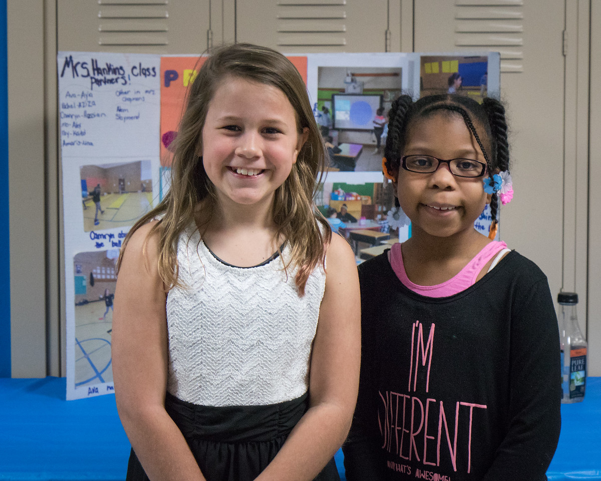 Ava Croft and Jayla Still shared Project Unify with visitors. Photo by Debbie Malyn.