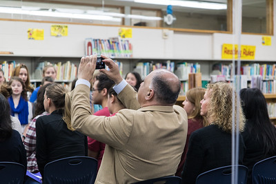 School Board Trustee Hussein Berry, and Jill Chochol, Executive Director of Student Achievement for Dearborn Schools, watch as the Whitmore-Bolles Eagle Chorus performs. Photo by Debbie Malyn.