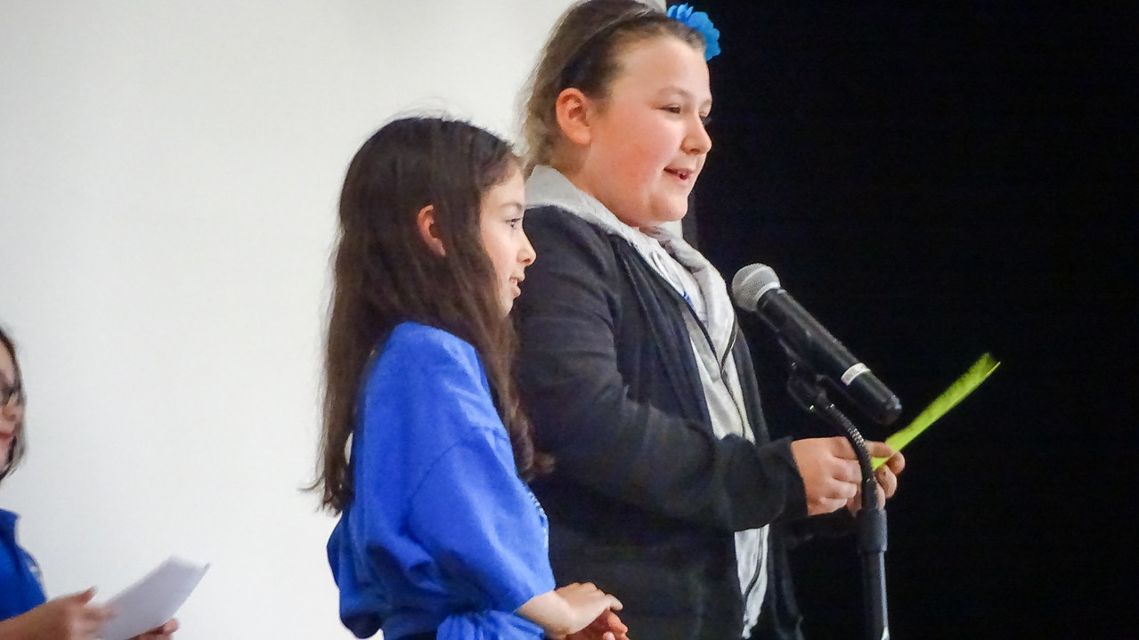 After meeting in mixed grade groups for Habit Time, Students share insights from their group at a school wide, student led assembly. This month's topic was Habit 5: Seek first to understand, then to be understood. Photo by student Broadcast Club member Lily Majcher.
