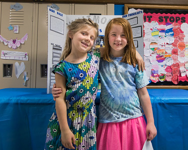 Student Assembly emcees Lola Moran and Molly Nachtrieb explained thier leadership roles together during the station walk. Photo by Debbie Malyn.