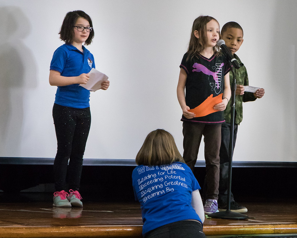 . After Habit Time, students presented what they learned at an assembly for students, staff and participants. Emcee Sophia Nowak looks on as Kenzie Good and Lamar White share. Photo by Debbie Malyn.