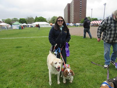 Meghan McGarth brought her two pets to the Dearborn Animal Shelter's annual Mutt Strut and Pet Expo May 14 at Ford Field.   Photo by Micah Walker