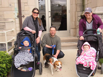 From left to right: Leah and Chris Ventura, dog Enzo, and Laurie Howell make the Mutt Strut a family outing.