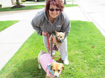 Ann Marie Boudrie poses with her pets Bruiser and Gretchen at the 11th annual Mutt Strut.