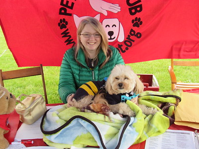 Cari Cook poses with her dog, Casey at the Pet-A-Pet Club tent at the Mutt Strut.