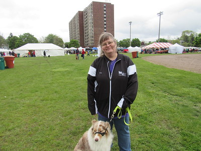 Karen Riegel poses with her dog, Ophelia at the 11th annual Mutt Strut.   Photo by Micah Walker