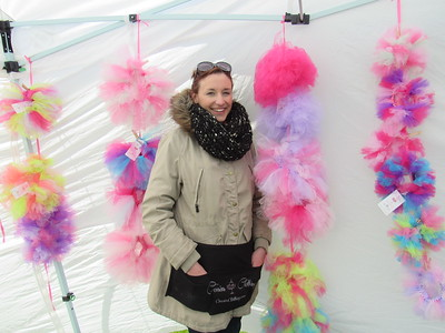 Rosemary Phillips poses with a set of tutus she designed at the Mutt Strut. She and her husband have their own canine line, Cousin's Clothing.