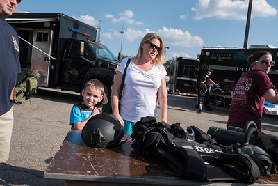John VanDerworp, age 5 from Dearborn Heights, checking out the SWAT gear. Photo by Debbie Malyn for the Press & Guide.