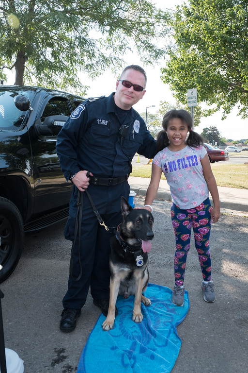 . Brooklyn Doss with Beaumont Security Officer Scott Tuttle and his K-9 dog Taylor. Photo by Debbie Malyn for the Press & Guide.