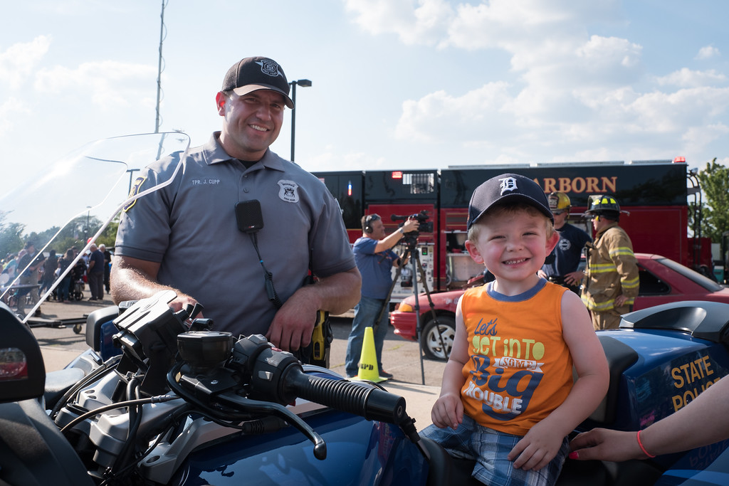 . Easton Galloway tries out a State Police motorcycle. Photo by Debbie Malyn for the Press & Guide.