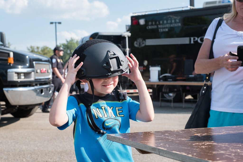 . John VanDerworp, age 5 from Dearborn Heights, checking out the SWAT gear. Photo by Debbie Malyn for the Press & Guide.
