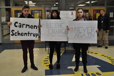 Annapolis High School students take part in the National School Walkout on Wednesday morning while holding up signs bearing the name of the 17 teens killed in the Feb. 14 mass shooting at Marjory Stoneman Douglas High School in Parkland, Fla. Photo by Karen Hain -- For The Press & Guide