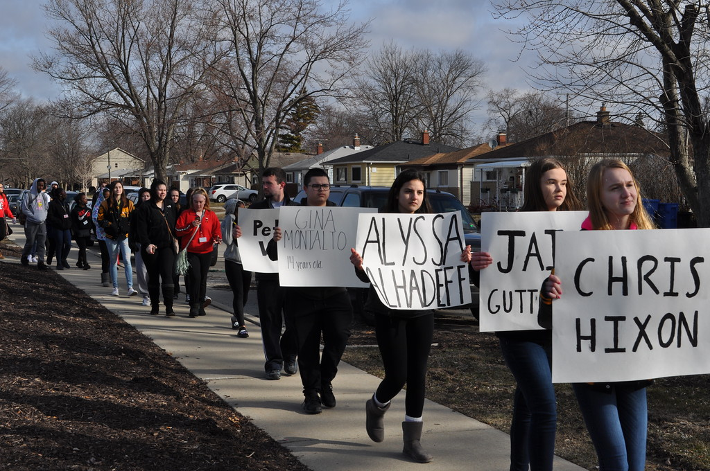 . Annapolis High School students take part in the National School Walkout on Wednesday morning while holding up signs bearing the name of the 17 teens killed in the Feb. 14 mass shooting at Marjory Stoneman Douglas High School in Parkland, Fla. Photo by Karen Hain -- For The Press & Guide