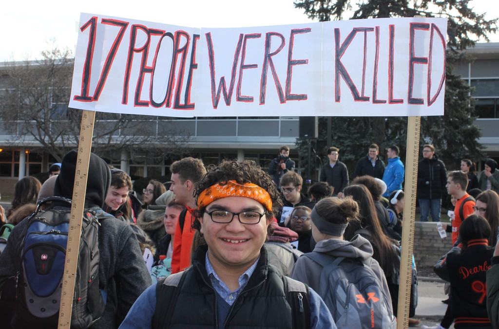 . Dearborn High School student Ryan Chatila takes part in the National School Walkout on Wednesday morning. Photo by Sue Suchyta -- For The Press & Guide