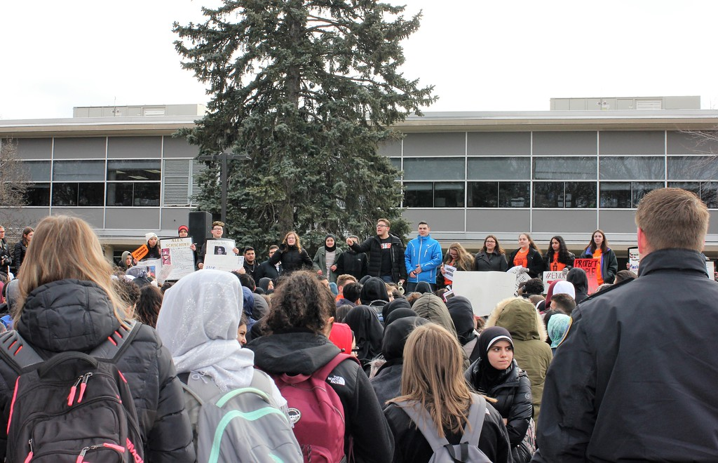 . Student Adam Bazzi shares his thoughts during Wednesday\'s walkout at Dearborn High School. Photo by Sue Suchyta -- For The Press & Guide