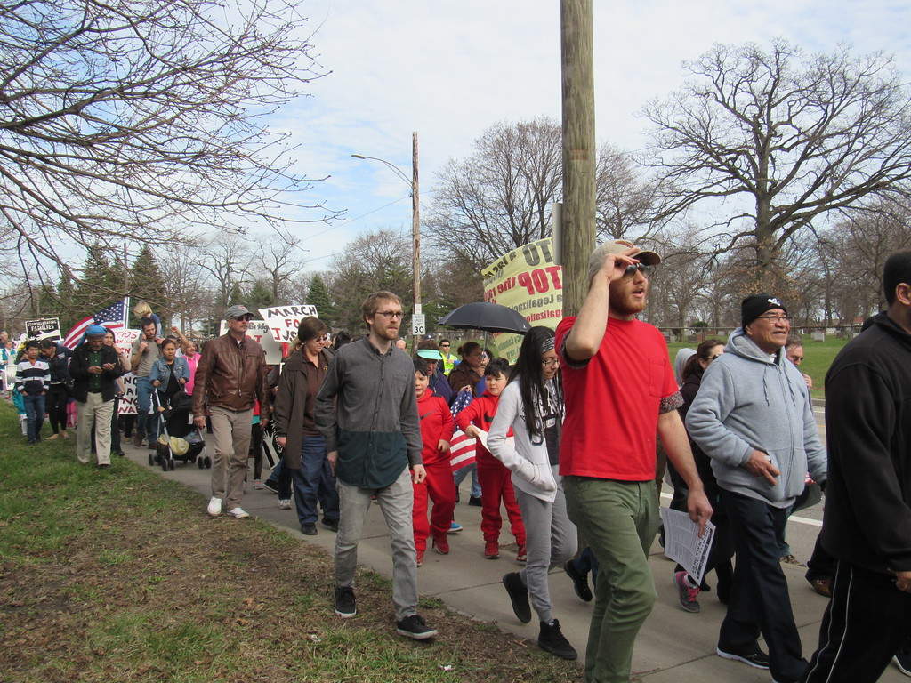 . At least 200 metro Detroiters walked in the Neighbors Building Bridges march Sunday, April 2.
