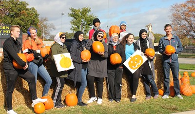Jacob Lambert (left), Macenzie Landon, Aya Hammoud, Marwa Alkhalby, Ali Alzergani, Yasmine Fardous, Batoul Hammoud, Mohammed Alzergani, Lissabele Salman, Zaynab Turki and Hussein Sobh are among the Dearborn High School Kiwanis Key Club volunteers on Oct. 28 who helped run the pumpkin patch.