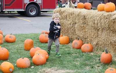 Gabe Grange, 3, of Redford Township eagerly runs amid the pumpkins Oct. 29 at the Dearborn Fire Safety House Pumpkin Patch.