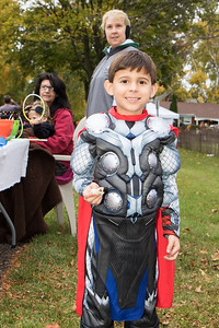 Carter Nonis put down his Thor hammer to sample his candy. Photo by Debbie Malyn for the Press & Guide.