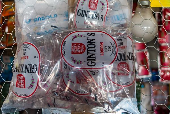 packets of cheap whiskey shots. Bangem, Southwest Region, Cameroon Africa