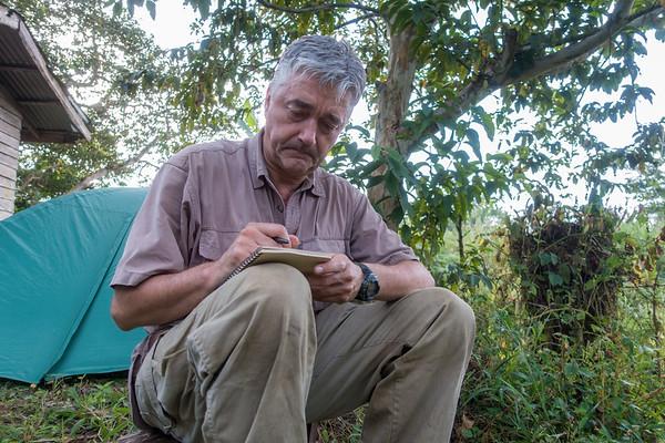 Hans-Werner making a field book entry. Edib, Southwest Region, Cameroon Africa
