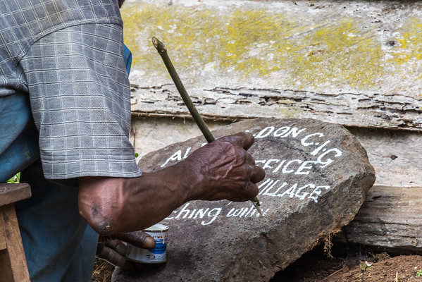 Caretaker painting sign. Edib, Southwest Region, Cameroon Africa