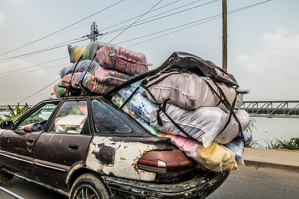 Typical overloaded vehicle. Douala, Littoral Region, Cameroon Africa