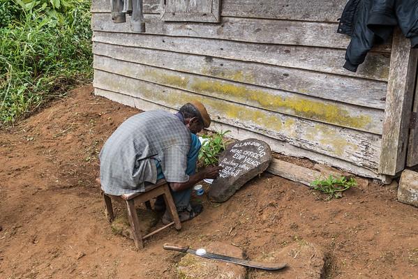 Caretaker painting sign. Edib, Southwest Region, Cameroon Africa