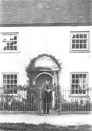 "<center><font size=3><u> - Fairlight, Castle Square - </u></font> (BS0341)  Mr Thomas Pether leaning on the gate of his house formerly between The White Hart Hotel and the Castle Farmhouse and called Fairlight.  To his right and between his property and the Hotel was a wooden shed used as both the location of the old fire engine (see BS0052) and a morgue.  All three buildings are clearly shown on BS0330.  Mr Pether's son was George Pether who later became the Landlord of the ""Three Horseshoes"" pub between 1937 and 1952 - see ""Benson A Century of Change"", page 211.  </center>"