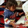 little boy stacking goods at a shop. Quito Ecuador