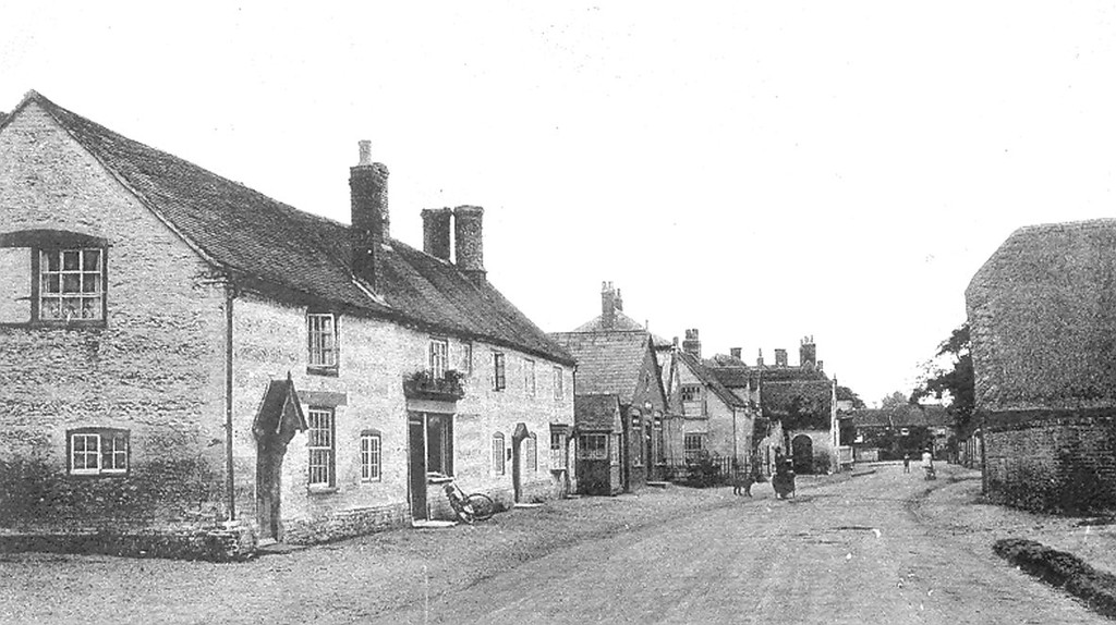 "<font size=3><u> - High Street (prob pre WW1) - </u></font> (BS0393) Note village store where 21st century Co-op is, later to become known as ""Slaughters"" and managed by Len Snugs.  Note also small shop next door. This was Pengilley's Dairy shop, and later still Stan Blissit's barber's shop.  The small shop with the 'bike outside was a butcher's.  College Farm dominates all, on the right of the picture.  Many thanks to Keith Slaughter for the following ""Slaughters Stores was owned by Gordon Slaughter, wife Gladys and children Douglas and Molly who lived next door.  When Gordon took over the store from the drapers he took out the vine lowered the roof of the greenhouse and planted tomatoes among other vegetables."""