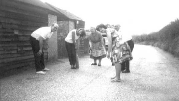 """<font size=3><u> - The Beaven family outside no.19 Littleworth Road - </u></font> (BS0186)  A Sunday about 1963.  Left to right Ian Huntinford, Christine, Ethel & Tom Beaven, Mary Barton. Pandora Huntinford commented """"We used to get very annoyed when traffic stopped play!"""""""