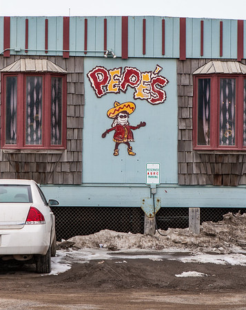 Pepe's Mexican Resturant, North of the Border sign. Barrow Alaska USA