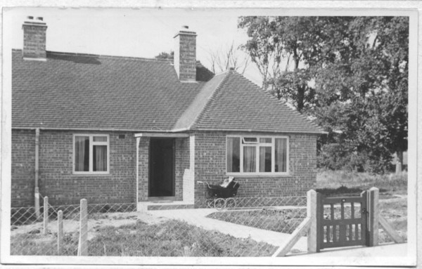 "<font size=3><u> - Sunnyside bungalow - </u></font> (BS1006)  This early picture is of 30 Sunnyside.  The development began in 1946, and consists mainly of (at the time) Council, or at least ""affordable"" properties around the new recreation ground, acquired by the Parish Council to replace the former village recreation ground which had been lost when the 1942 By-pass was built.  Thanks to Maggie Jones for the information that the photo was taken about 1951 and her brother, Philip Coggins, is in the pram."