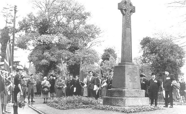<center><font size=3><u> - War Memorial - Early 1950s - </u></font> (BS0344)  Rememberance Parade.  Memorial put there in 1919.    Pre Early 1950s / second world war?   The names are on for the second WW.  Two of the standard bearers from the left are G Spiers and T Belcher.  No sea cadets in this village till after the 2nd WW, so this photo is 1950s.  Who is the chap on the right – standard bearer - Roy Dancer's father? Tom Belcher </center>