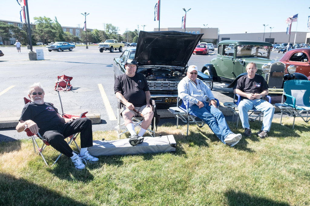. Bob Hemphill (left), Don Burnham and Frank Moran of Carleton, and PJ Johnson of Brownstown sit in front of their cars at Southgate Ford. Despite several cities urging cruisers to stay home, the 18th Annual Cruisin\' Downriver kicked off Saturday morning. Photos by Matt Thompson for The News-Herald